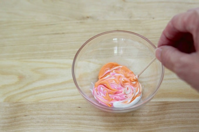 Swirling candy melts with a toothpick