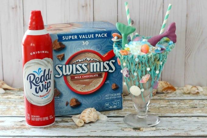 Swiss Miss and Reddi-wip with mermaid milkshake