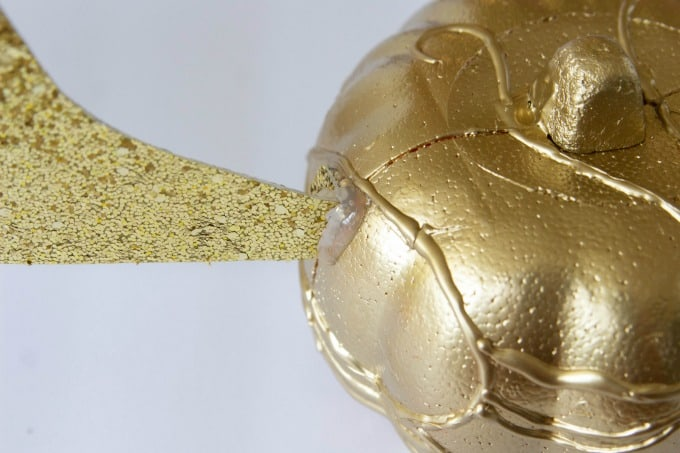 Wing glued to Golden Snitch pumpkin