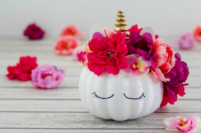 Unicorn pumpkin surrounded by flowers