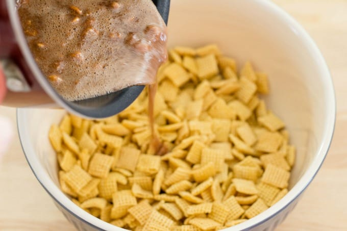 Pour the Snickers mixture over the Chex cereal