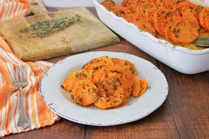 Garlic roasted sweet potatoes on plate