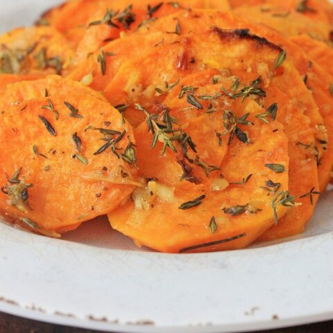 Roasted sweet potatoes on plate vertical