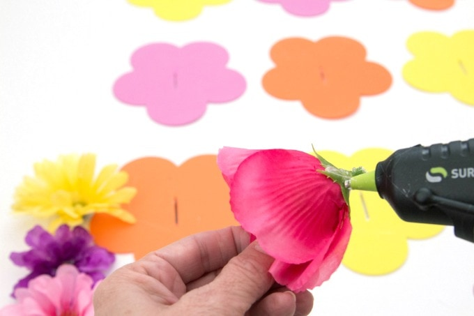 Putting hot glue on flowers