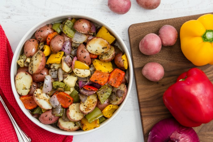 Roasted potatoes and veggies in bowl on table