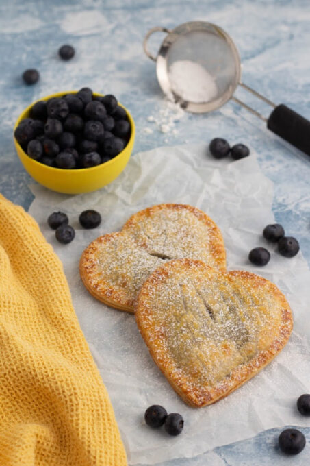 Blueberry hand pies with sugar and blueberries