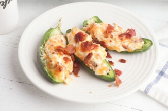 Jalapeno poppers on white plate