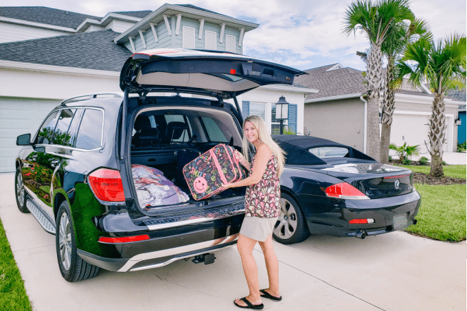 Loading suitcases into car