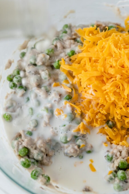 Combining tuna, cheese, peas and more