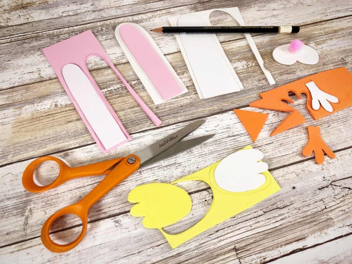 Cutting out craft foam for the tin can Easter crafts