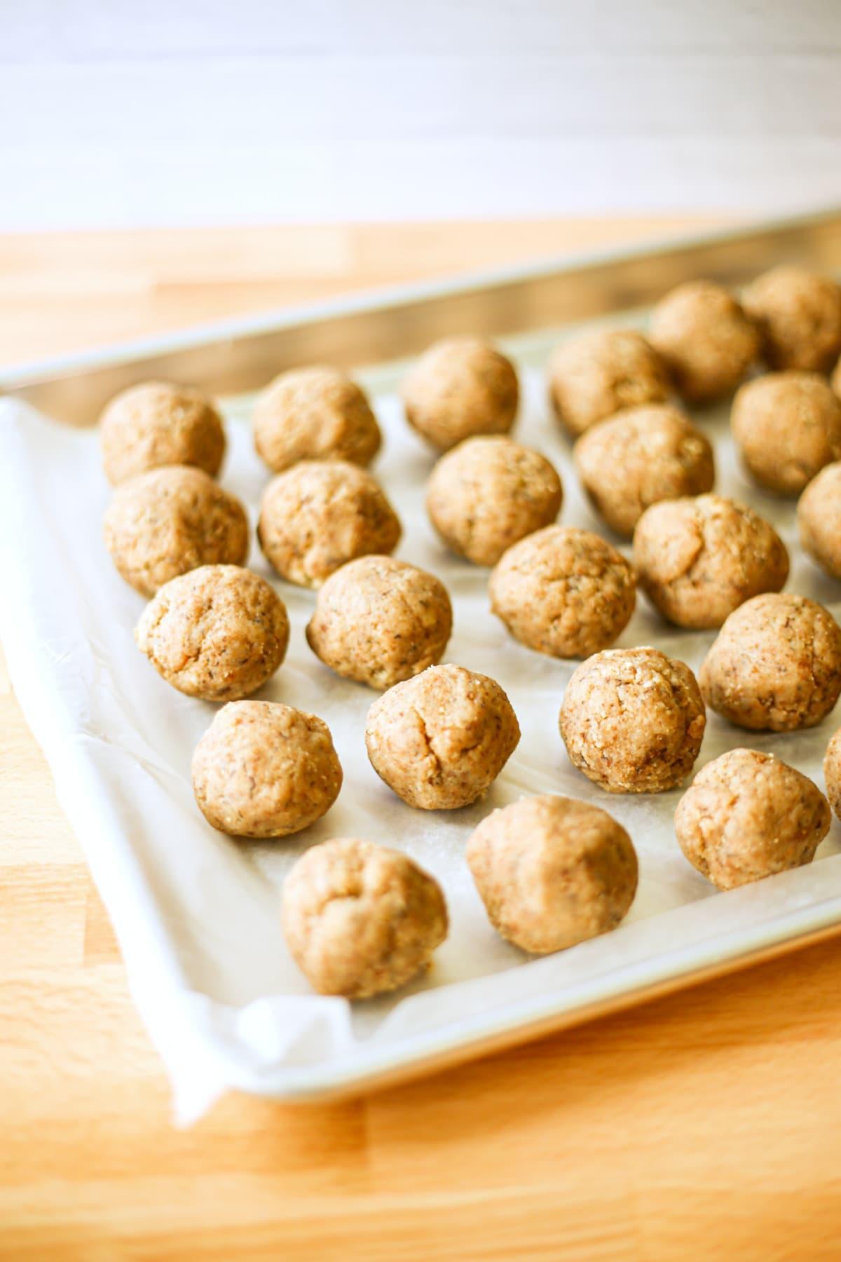 Cake balls on a baking pan