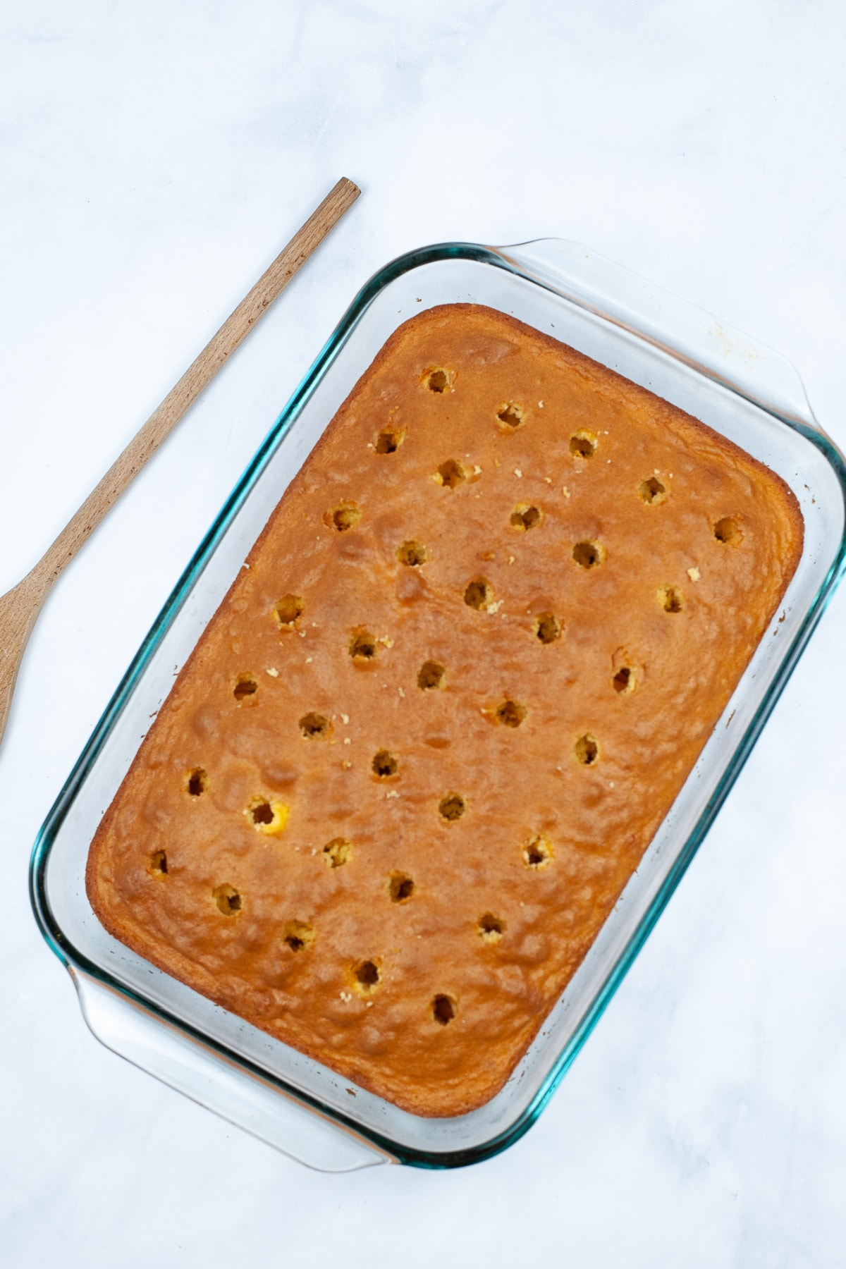 Cake with holes poked in it