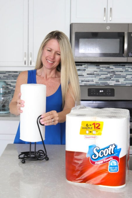 Placing roll of Scott Towels on paper towel holder