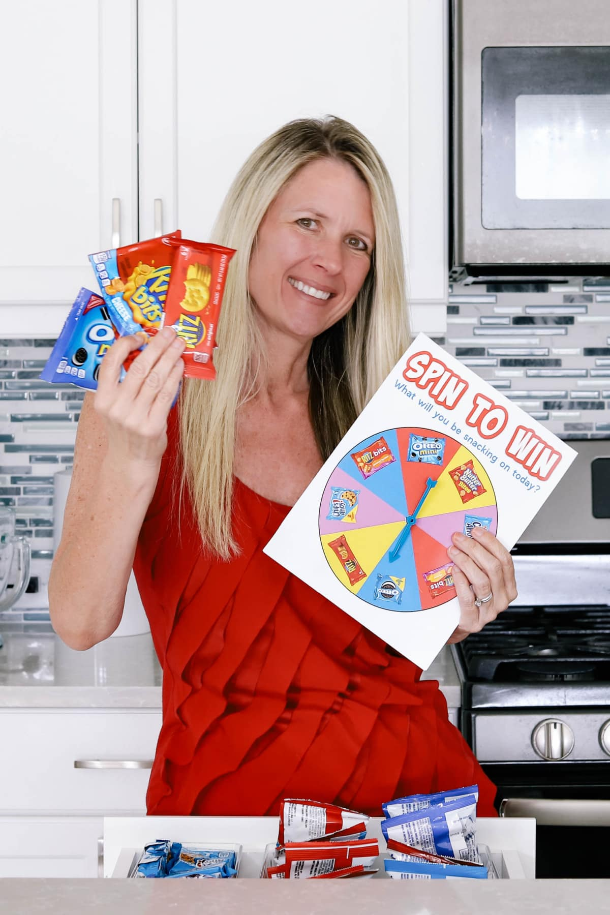 Woman with spinner game and snacks