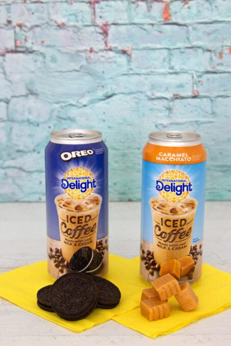 International Delight cans with candy and cookies