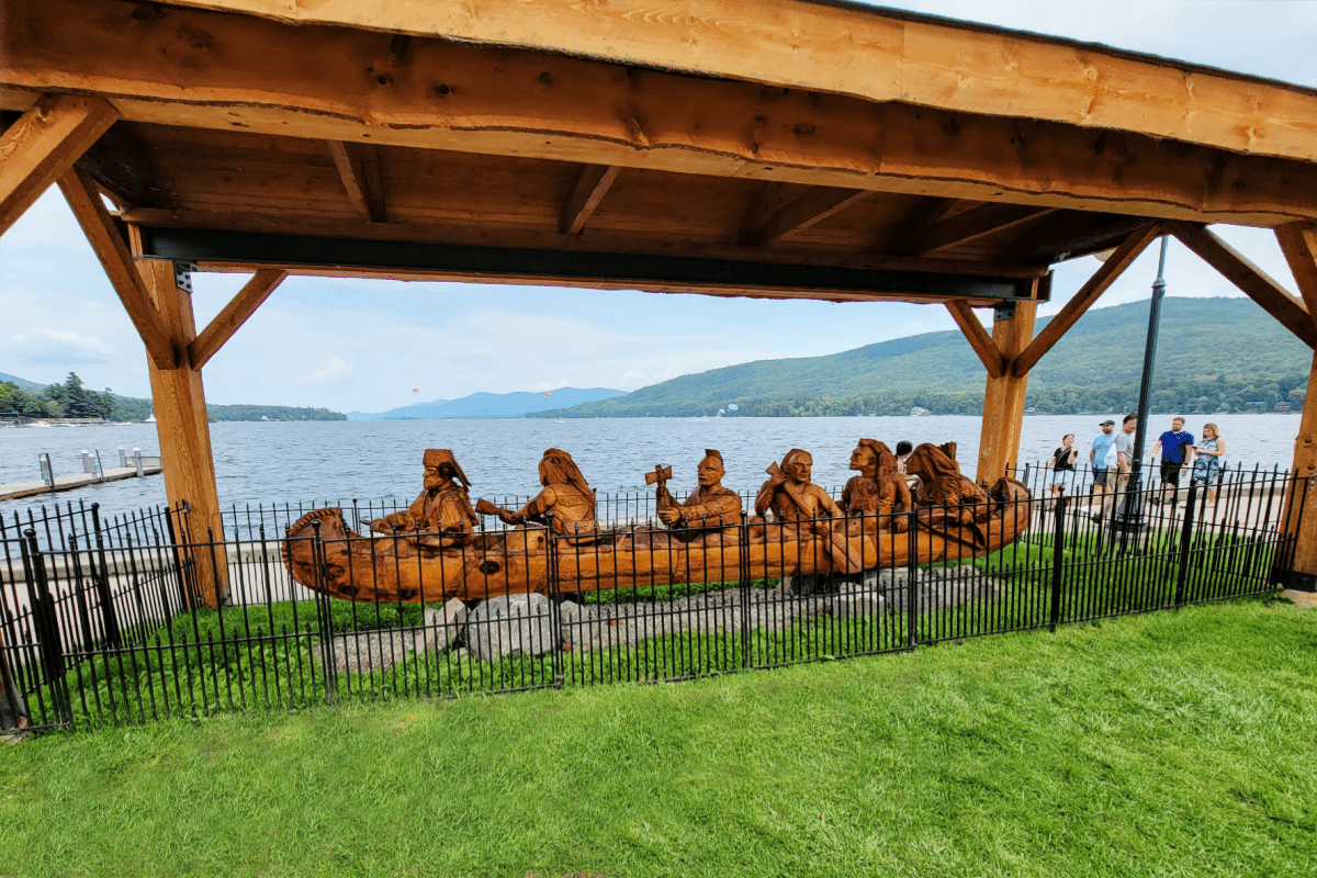Carved wooden canoe with indians