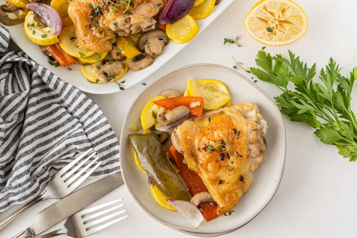 Sheet pan chicken on plate with veggies