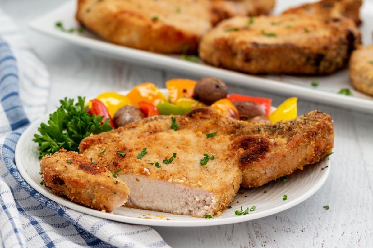 Breaded pork chop cut open