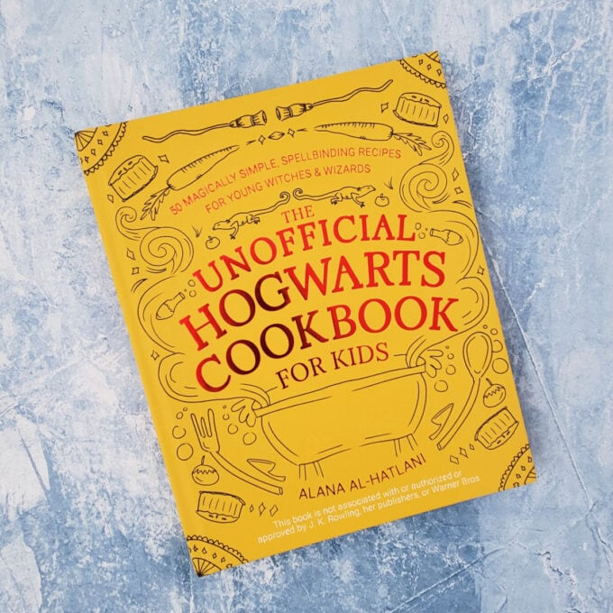 The Unofficial Hogwarts Cookbook on blue background
