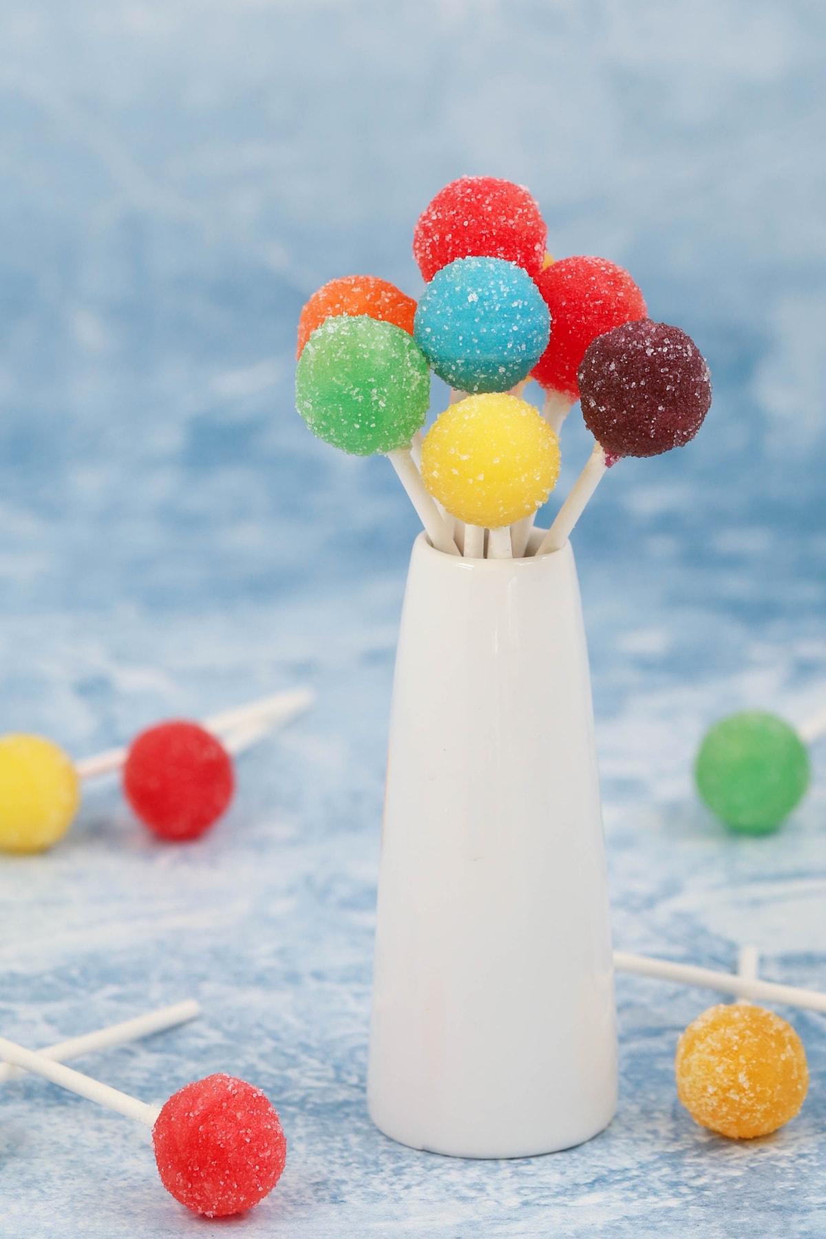 Acid lollipops in white vase