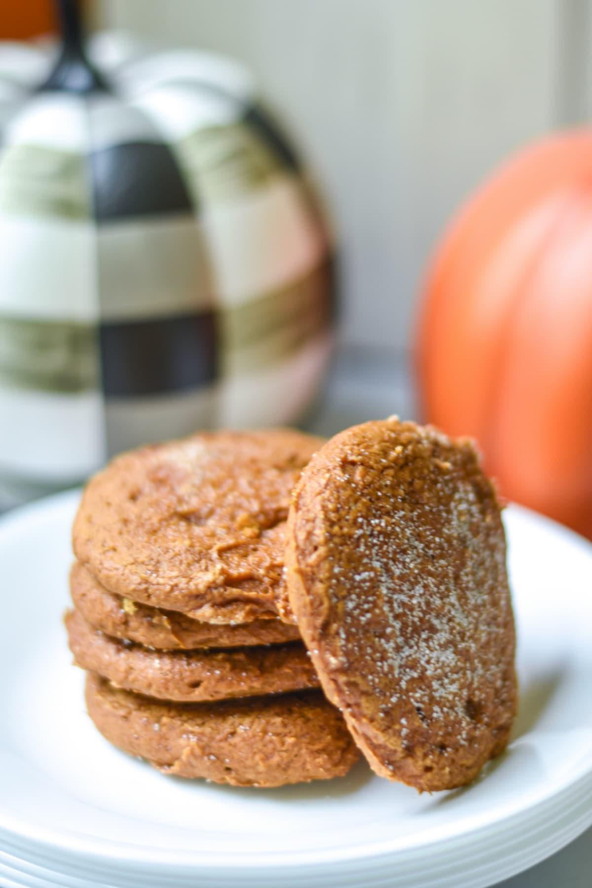 Pumpkin cookies on white plate