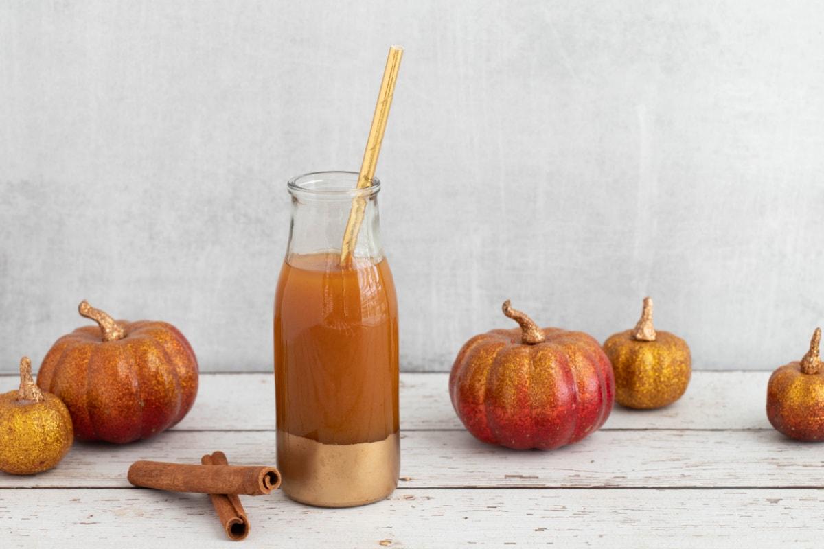 Harry Potter pumpkin juice with cinnamon sticks