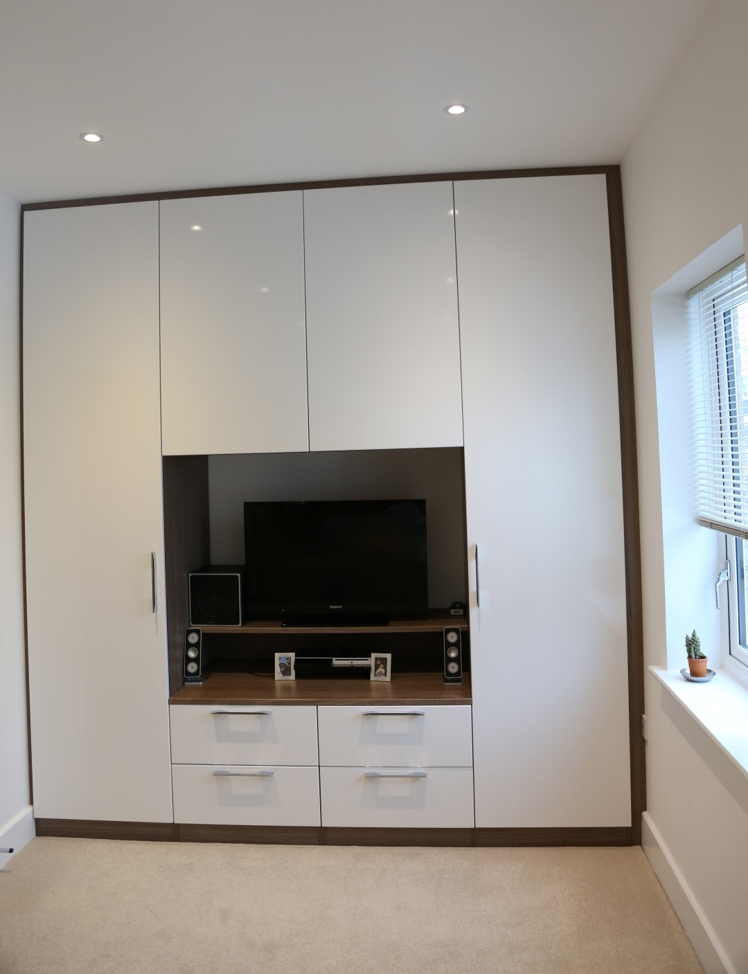 15 Photos Built In Wardrobes With Tv Space Wardrobe Ideas