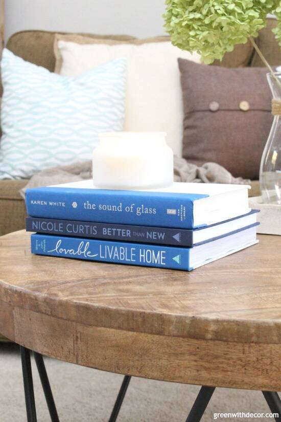 The best coffee table books about decorating   Green WIth Decor Rustic round wood coffee table with blue interior design coffee table books  with a candle and