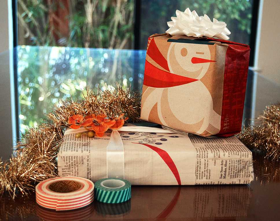 Eco friendly gift wrapping tips and tricks     Harker Aquila Old newspaper and brown paper shopping bags are a great way to reuse  everyday materials as