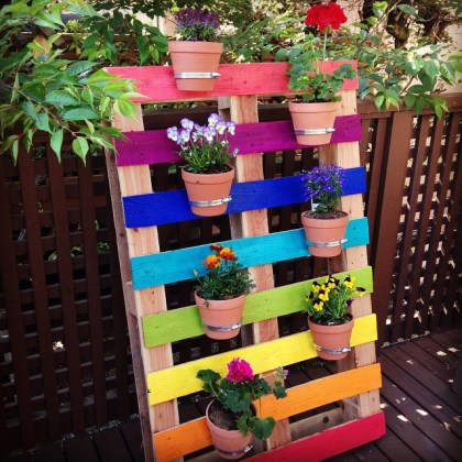 How to Make A DIY Upcycled Rainbow Pallet Flower Garden Planter     Create a bright and colorful upcycled rainbow pallet planter project with  these simple instructions from Hello