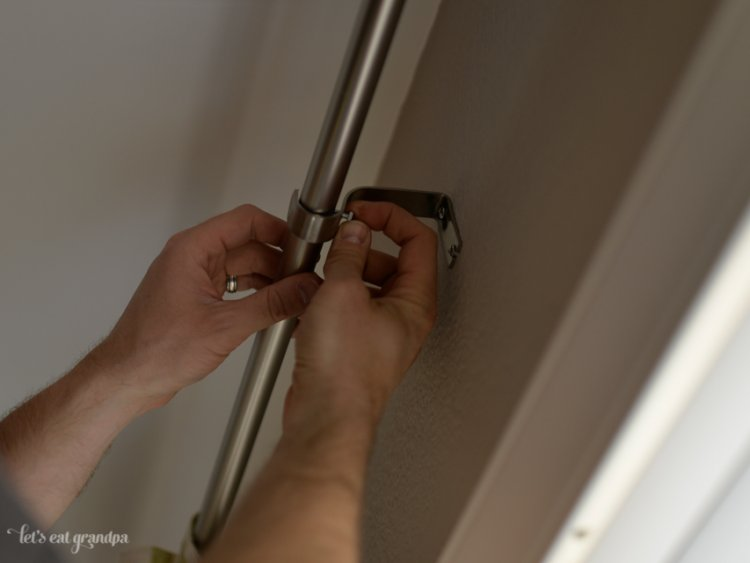 hands mounting bracket to wall