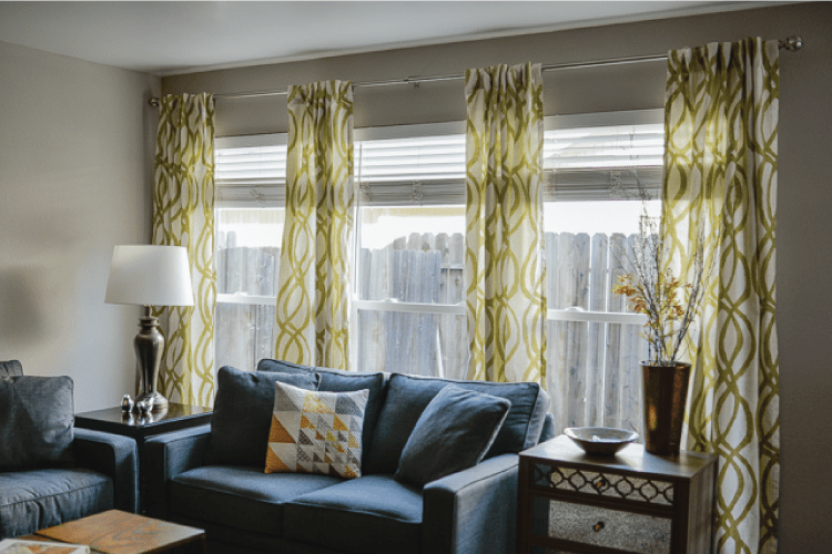 finished curtains hung to the wall in living room