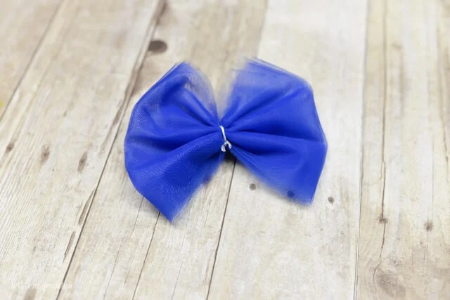 blue tulle wrapped up in a bow