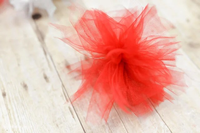 closeup of red firework poof from tulle