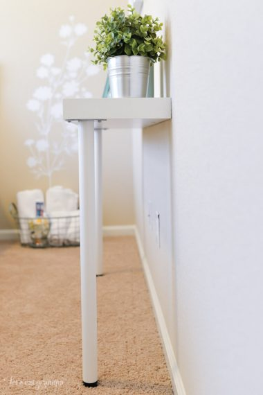 Need a storage table but short on space? You can hack together this IKEA console table for just $22!
