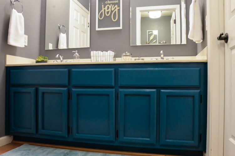 finished painted teal bathroom cabinets