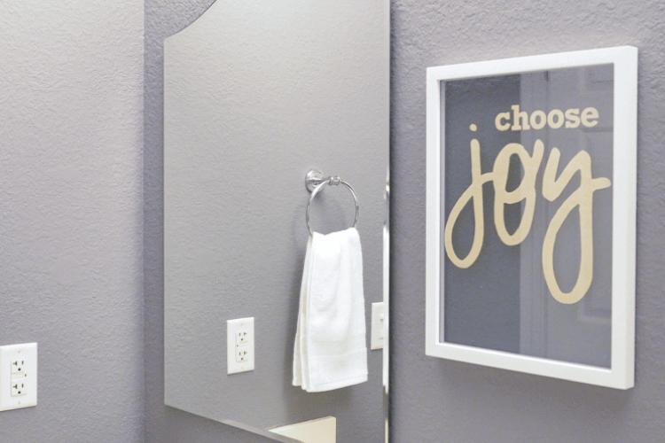 Choose joy floating artwork in bathroom