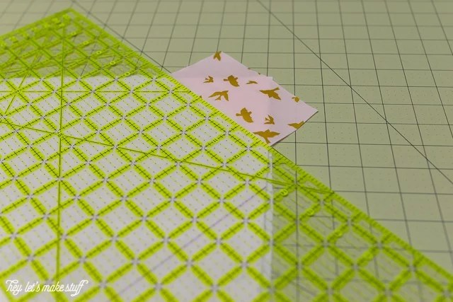sewing ruler and fabric on sewing mat