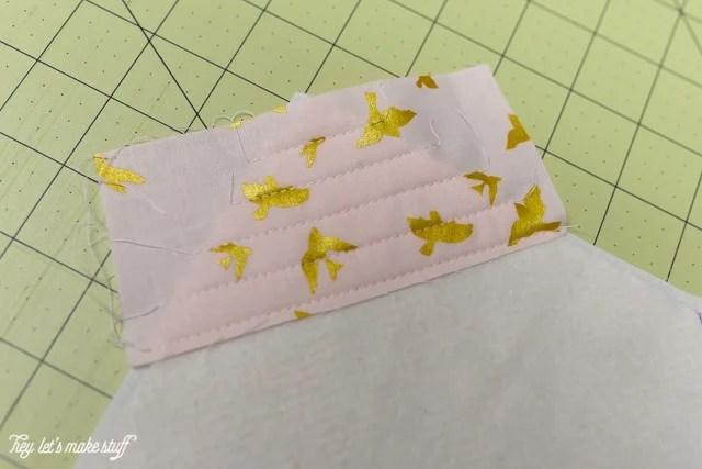 fabric corner on sewing mat and batting