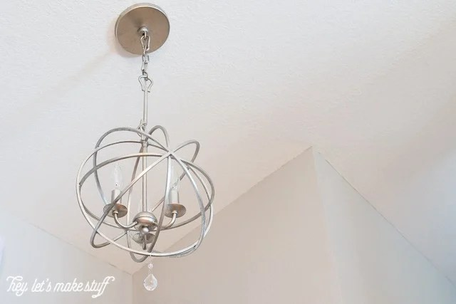 new updated light fixture hanging from ceiling
