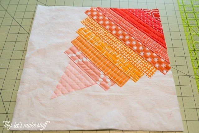 fabric strips for Go Fly a Kite QAYG finished quilt block
