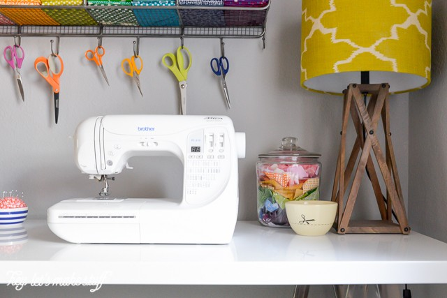 sewing machine on table in colorful craft room