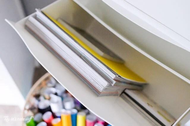 Scrapbook paper organized in IKEA Hack: Trones Shoe Holders