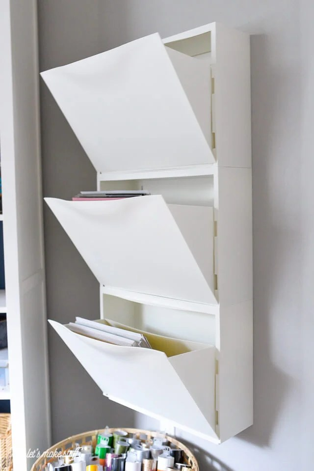IKEA Trones Shoe Holders mounted on wall to hold paper