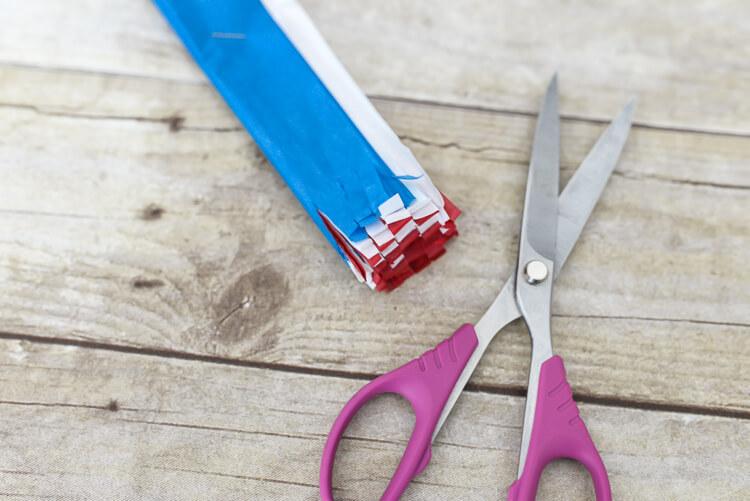 make tissue paper fireworks - cut fringe on both sides