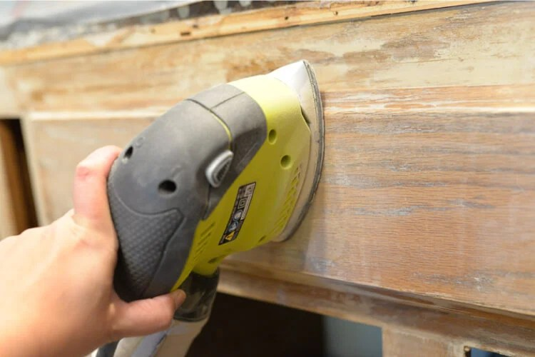 sanding the kitchen cabinets