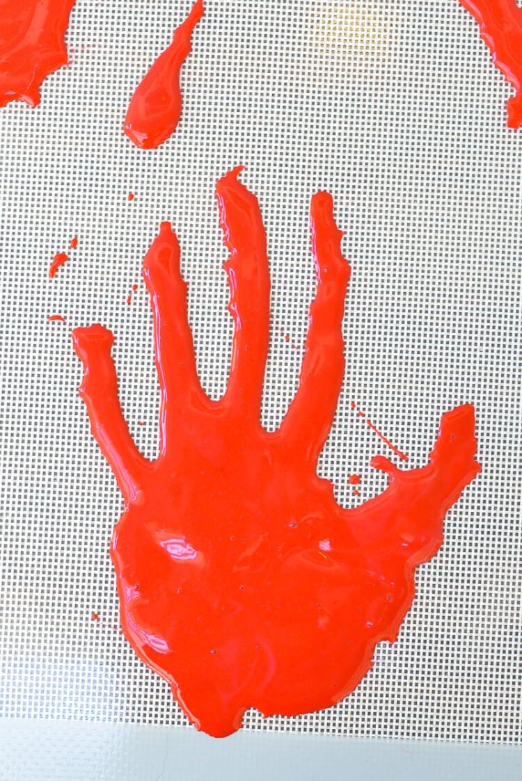 DIY Halloween decoration -- bloody handprint window clings!