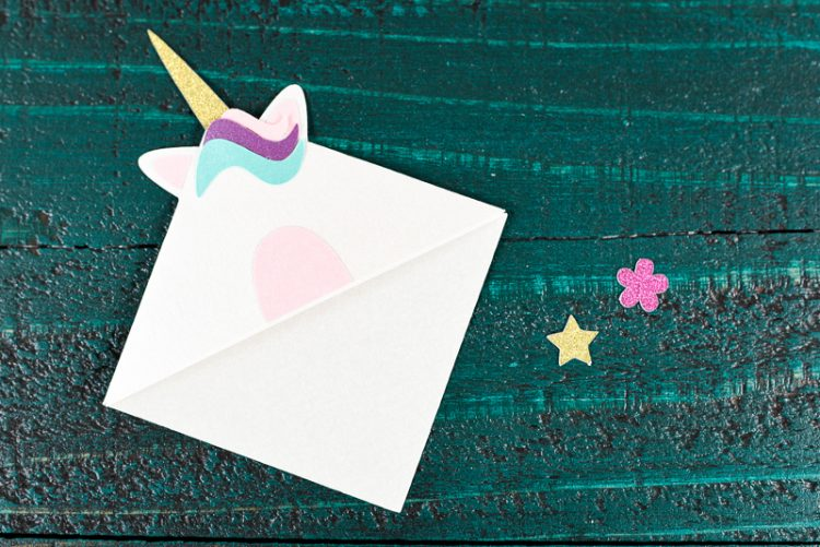 Glue the unicorn's hair - Make these adorable little unicorn bookmarks! The perfect craft for any time you're diving into a particularly whimsical book. A FREE SVG and DXF download.