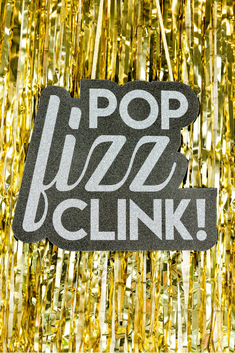 This Pop Fizz Clink SVG is a delightful addition to your New Year's Eve projects made with your Cricut or Silhouette! Make a fun New Year's Eve sign, t-shirt, or even photo booth prop.