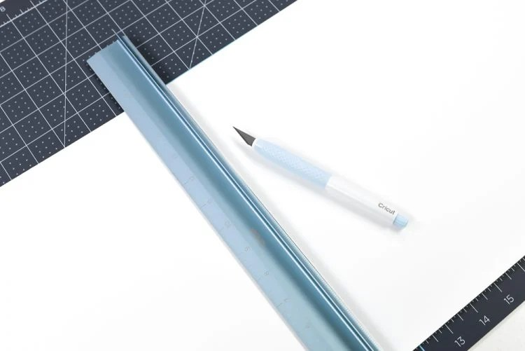 Trim down matboard with craft knife and ruler